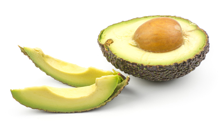 Two avocado slices and one green brown half with a seed isolated on white background ripe alligator pear