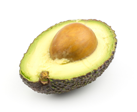 One avocado half with a seed isolated on white background ripe green brown alligator pear