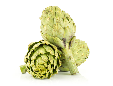 Three globe artichoke set isolated on white background fresh raw green