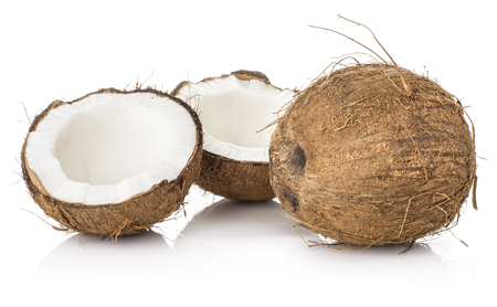 Coconuts two halves and one nut isolated on white background brown fibrous shell with milk meat  Stock Photo