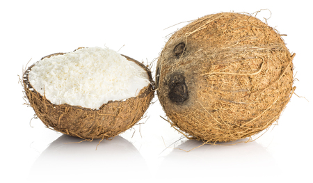 Coconut and one half filled with shavings isolated on white background brown fibrous shell with milk meat  Stock Photo