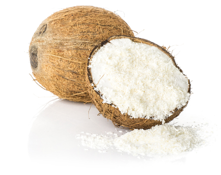 Coconut and one broken half filled with shavings isolated on white background brown fibrous shell with milk meat