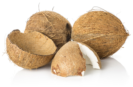 Coconut set two nuts and one broken half isolated on white background brown fibrous shell with milk meat