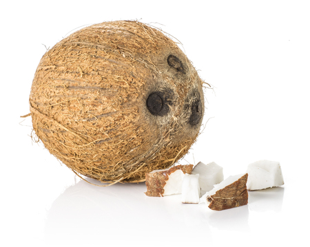 One coconut with three pieces isolated on white background brown fibrous shell with milk meat  Stock Photo