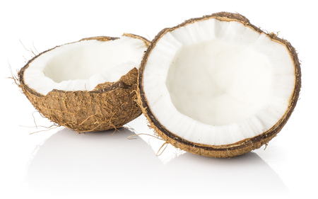 Two coconut section halves isolated on white background one broken in two brown fibrous shell with milk meat  Stock Photo