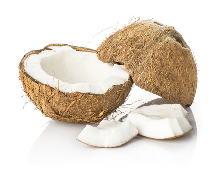 One cracked coconut in halves with two pieces isolated on white background brown fibrous shell with milk meat