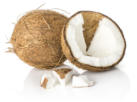 One coconut broken half with three pieces isolated on white background brown fibrous shell with milk meat  Stock Photo