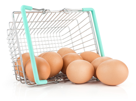 Brown chicken eggs out a shopping basket isolated on white background raw