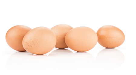 Brown chicken eggs stack isolated on white background set of five domestic