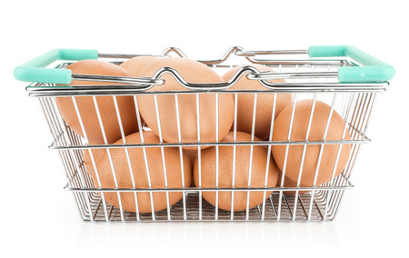 Brown chicken eggs in a shopping basket isolated on white background