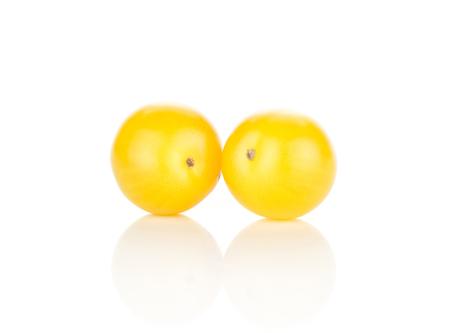 Two yellow grape cherry tomatoes isolated on white background Stok Fotoğraf