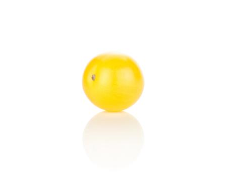 One yellow grape cherry tomato isolated on white background