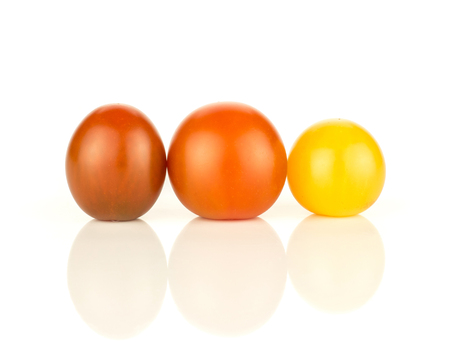 Three grape cherry tomatoes mix isolated on white background yellow black red in row