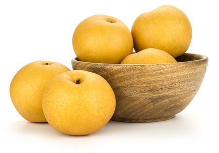 Chinese golden pears in a wooden bowl Nashi variety isolated on white background composition