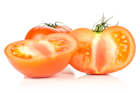 Red tomato cut in two section halves and one whole isolated on white background Stok Fotoğraf