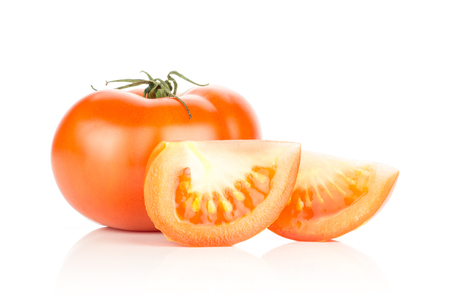 One red tomato with two slices isolated on white background  Stock Photo