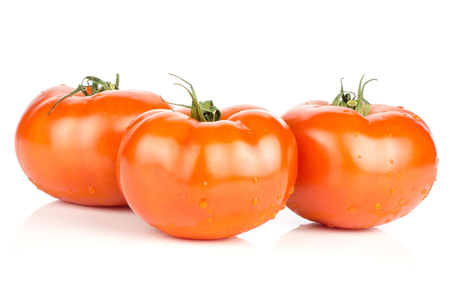 Three red tomato stack with vine ends isolated on white background fresh whole