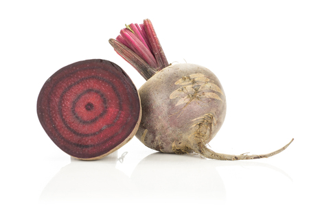 Red beet one bulb and section half isolated on white background cross section zoned flesh