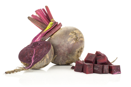 One red beet with section half and sliced squared pieces young bulbs isolated on white background