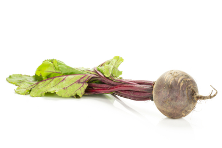 Red beet with greens isolated on white background one bulb root with leaves