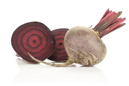 Sliced red beet one cut in two halves and whole bulb isolated on white background cross section zoned flesh