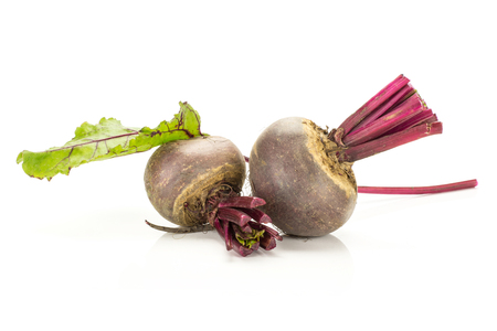 Red beet with cut tops two bulbs and green leaf isolated on white background