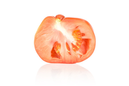 One beef tomato half isolated on white background big ripe red cross section Stok Fotoğraf
