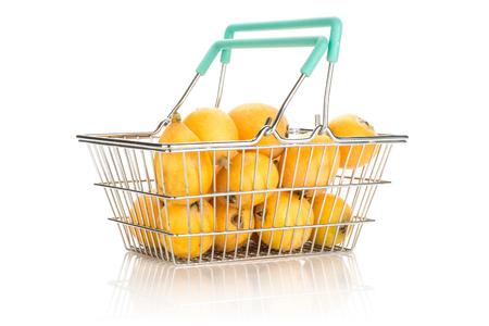 Fresh orange Japanese loquats in a shopping basket isolated on white background  Stockfoto