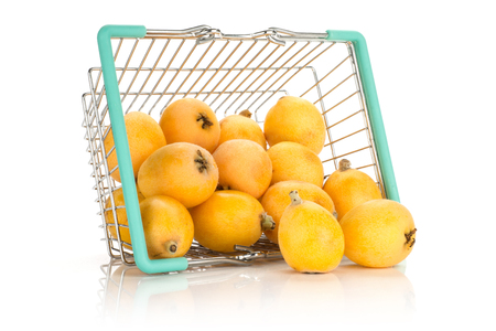 Fresh orange Japanese loquats out a shopping basket isolated on white background  Stockfoto