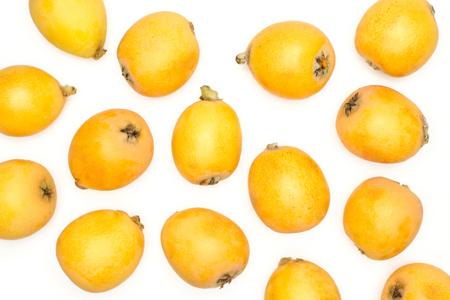 Fresh orange Japanese loquats flatlay isolated on white background