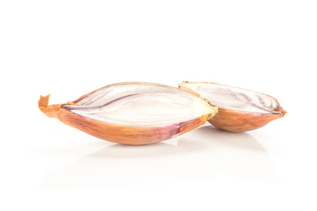 Two golden shallot halves isolated on white background  写真素材