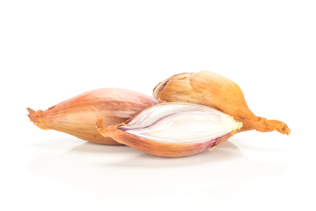Two golden shallots with one section half isolated on white background 写真素材 - 102895745