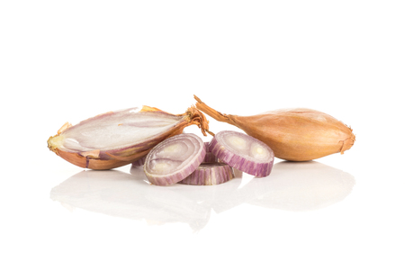 Shallot set one unpeeled with a half and sliced rings isolated on white background  写真素材