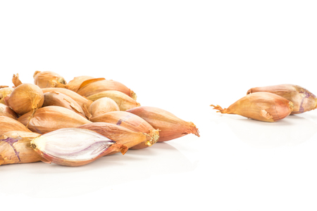 Golden shallots stack isolated on white background  写真素材