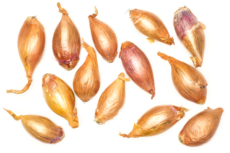Long golden shallots top view isolated on white background  写真素材