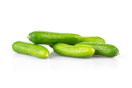 Five fresh green mini cucumbers isolated on white background