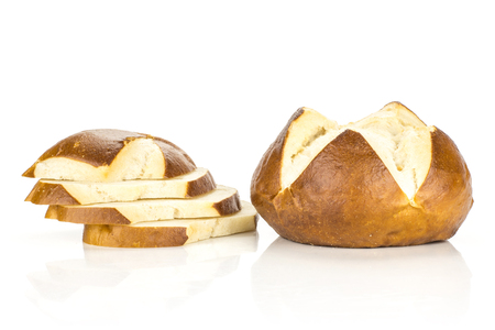 One Bavarian bread bun and four sliced pieces isolated on white background fresh baked loaves