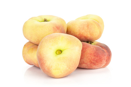 Fresh ripe Saturn peaches stack isolated on white background