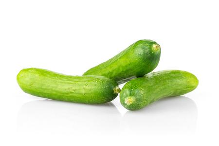 Three fresh green mini cucumbers isolated on white background Stock Photo