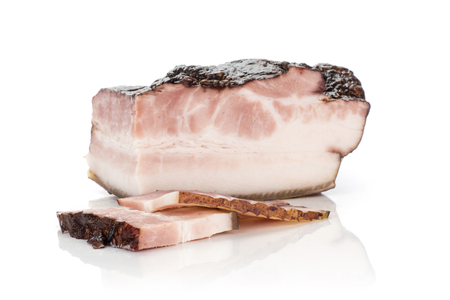Group of three slices one piece of english bacon isolated on white
