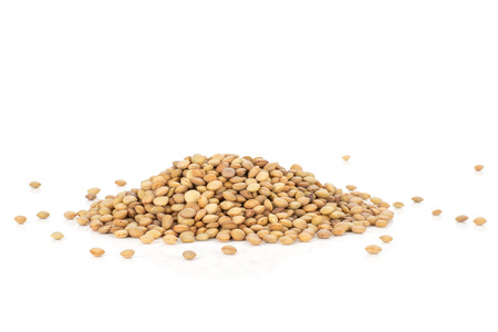 Lot of whole raw green lentil seeds heap isolated on white Stok Fotoğraf