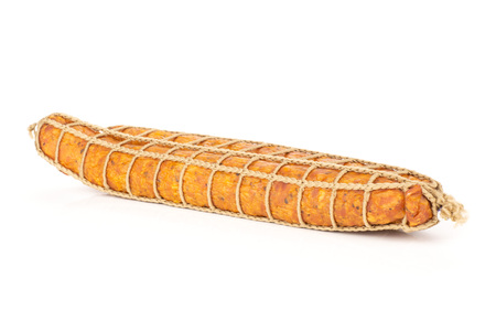 Group of two whole dry smoked ham sausage side view isolated on white