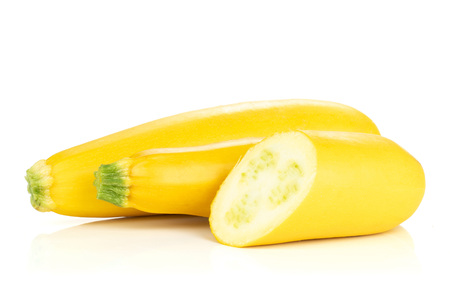 Group of two whole one half of raw yellow zucchini isolated on white Stock Photo