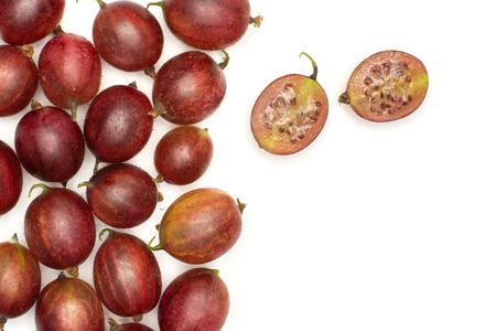 Lot of whole fresh red gooseberry hinnomaki variety one cut in two halves flatlay isolated on white Stock fotó