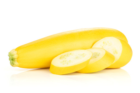 Group of one whole three slices of raw yellow zucchini isolated on white Stock Photo