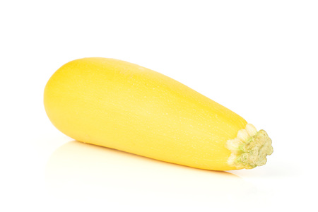 One whole raw yellow zucchini isolated on white