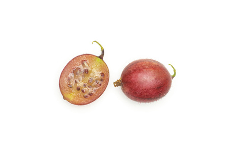 Group of one whole one half of fresh red gooseberry hinnomaki variety flatlay isolated on white