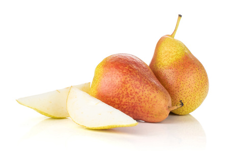 Group of two whole two slices of fresh red pear forelle variety isolated on white