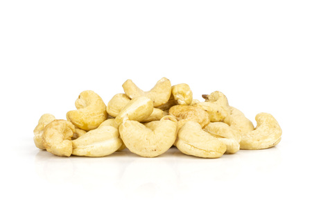 Lot of whole raw cashew nut heap isolated on white background Фото со стока