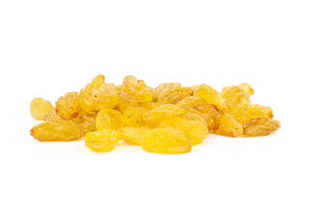 Lot of whole dry golden raisins sultana variety heap isolated on white background Archivio Fotografico